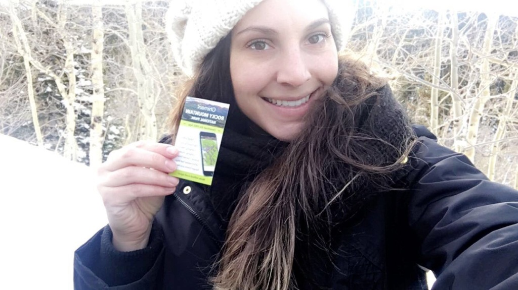 Taylor Hartman with a Rocky Mountain National Park app by Chimani Download Card