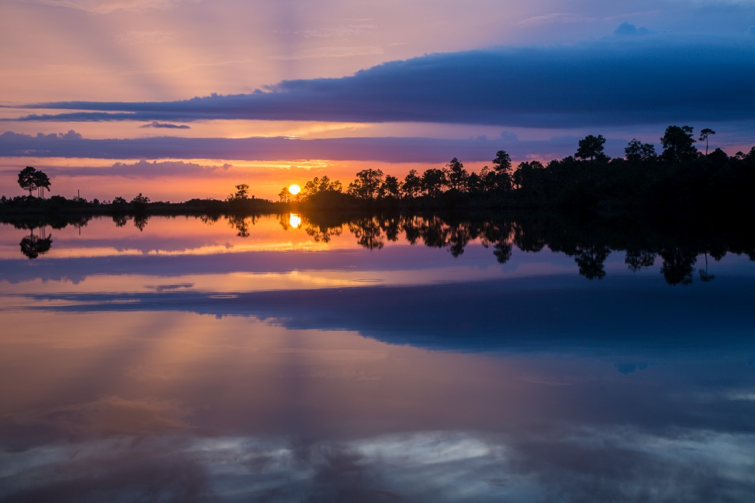 Sunset reflections, Pines Glades Lake. Everglades National Park, Florida, USA.