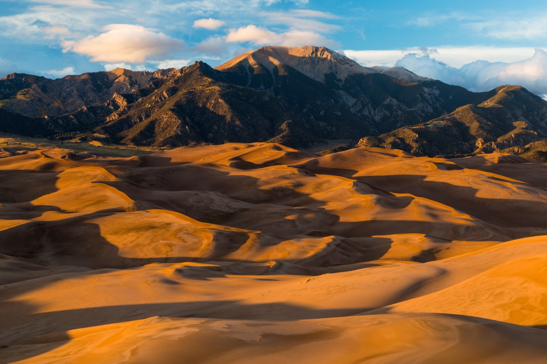 Distant view of the dune field and Sangre de Christo mountains at sunset. Great Sand Dunes National Park, Colorado (QT Tuan)